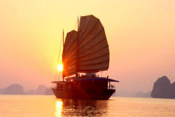 Huong Hai junk and sunset in Halong Bay, Vietnam